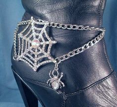 Large Crystal Spider Web with Spiders Just For Fun  Fashion Accessory--Ride In Style  Unique Handmade Gift for you or a Friend. Does Your Mom or Grandma Ride a Honda or a Harley? Yes they need one too!  CONDITION: Brand New STYLE: boot, ankle or shoe jewelry ITEM: single chain, if you need a set, please purchase two. THEME: spider web, Halloween METAL: mixed metals, steel, iron, plated and alloy. LENGTH: adjustable to 15. COLOR: silver This piece is handmade to order--all the chains and…