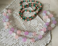 Check out this item in my Etsy shop https://www.etsy.com/listing/489754398/retro-1980s-pastel-necklace-duo-vintage