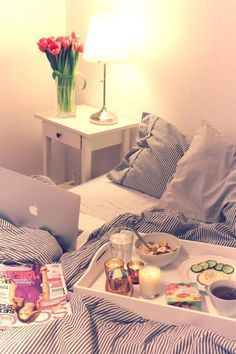 all my fav things: bed, laptop, food