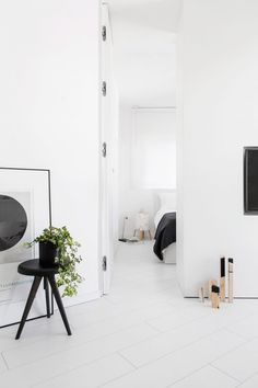 When transforming this skinny Tel Aviv apartment into a family holiday home, Yael Perry opted for bright white colour palette to make the space seem bigger.