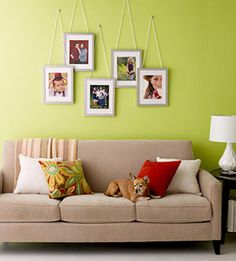 Layered Look: To give an assortment of silver-framed photos instant chic, suspend them from braided white cords, letting the frames overlap slightly.