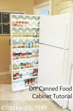 DIY Rolling Pantry for Canned Food: This sliding shelf on casters lives in the inches between the fridge and wall, and is perfect for holding canned foods and spices.  An ingenious way to save the space in the tiny kitchen!