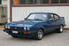 Ford Capri. I bought a brand new Mk 3 1600 GL in forest green with a tan vinyl roof. It was a lovely car
