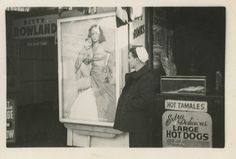 Vintage 1940s snapshot of a sailor checking out a Betty Rowland poster posted outside a burlesque theater.
