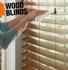 Wooden blinds are a common window treatment in which slats of wood are strung together in a louvered fashion. When closed, they block light and offer privacy, when open they allow sunlight to shine through.