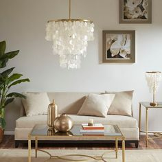 Madison Park Signature Isla Chandelier in White - Olliix elegant, the Madison Park Signature Isla Chandelier offers an eye-catching look for your home. A white shade features a shell shape that drapes beautifully complementing the gold Capiz Shell Chandelier, White Chandelier, Ceiling Pendant, Pendant Lamp, Master Bedroom Chandelier, Coastal Chandelier, Chandelier Ideas, Chandelier Lighting, Coastal Bedrooms