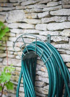 Image result for garden hose hanger