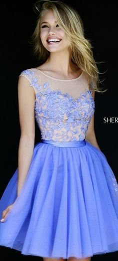sherri hill. she is beautiful! love her pretty dress!!