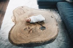 Circle of life. Newborn shoot, Baby on wooden coffee table