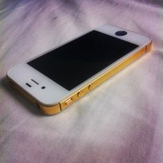 White iPhone 4S with golden trim