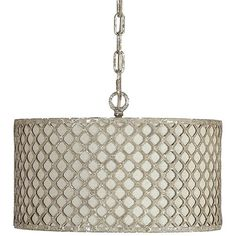The Vera Pendant light features detailed metal latticework surrounding a neutral linen shade. The realistic chipped antique silverleaf finish brings an old world feel to a modern form.  Materials: Metal/Linen Finish: Antique Silverleaf & Neutral Linen