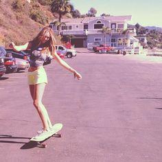 Candice on a skateboard