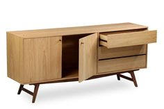 The Dualtone dining sideboard is a nice marriage between the combination of quality American wood - bright oak and dark walnut. Set in 50s/60s mid-century flavours and paired with a tinge of pale brass, the furniture stands out from the norm.