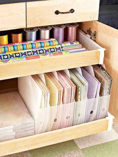 Make Supplies Accessible  :Polly sorted patterned paper by color and placed it in vertical storage boxes. The boxes and pullout drawers make it easy to find what she needs without having to rummage through messy mounds of paper.