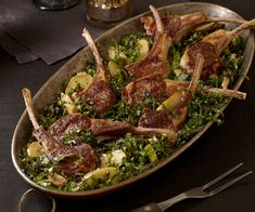 "RACK OF LAMB WITH KALE SALAD AND POTATOES: ~ From: ""Fine Cooking.Com"" ~ Recipe Courtesy of  Chef Jonathan WAXMAN (From Moveable Feast with Fine Cooking). Serves (4) ~ Pan-seared rack of lamb chops served on a bed of fresh kale tossed with roasted potatoes makes an elegant meal that's easy to prepare."