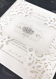Delicate Laser Cut Wedding Invitation with Art Deco Brooch. Our Infinity design.