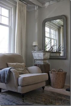 comfy chair - neutral decor lovingly repinned by www.skipperwoodhome.co.uk