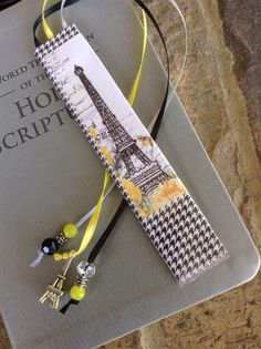 Bible Bookmark made to fit and be used with the regular sized New World Translation of the Holy Scriptures, but can be used with other regular/standard sized Bible translations. This listing is for the exact bookmark as shown in the photos. This is a Paris themed bookmark, and there are three ribbons - one black, one light gray and one yellow. Each ribbon has coordinating beading on the ends and the center ribbon has a silver Eiffel tower charm on it, exactly as pictured. This beading ad...