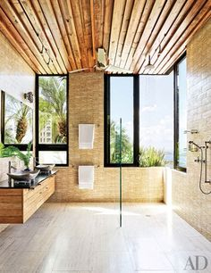 Step inside the ultimate master bathroom. Natural elemetns and textures create an insteresting composition with an unreal view. #architecture