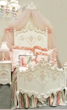 ♡ OMG...I THINK THAT'S THE MOST BEAUTIFUL BED I HAVE EVER SEEN!!!  AND THE TULLE,  AND THE BEDSIDE TABLE....AND IT'S HIGHLIGHTED IN PINK!!!  OMG!!!  MUSTMUSTMUST HAVE!  ♥A