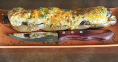 Old Bay Roma sausage in a pretzel roll, with house made Old Bay crab ...