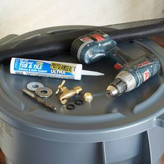 DIY Rain Barrel from a Trash Can- note: 500 sq ft roof gives 300 gallons of water in season