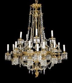 A Continental Neoclassical style gilt bronze and cut glass twenty-light chandelier circa 1900.