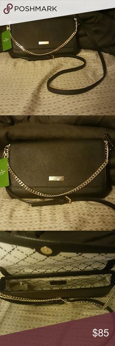 Kate Spade black w/ gold chain evening purse NWT from smoke free home, never used Kate Spade Newbury Lane black purse with gold chain. The chain can be put inside the bag if needed, it is a very light gold color. Super cute for a fancy or casual night out! Perfect size for the basic necessities for an evening out. Can be used as a crossbody or shoulder bag. Strap is adjustable. Got for a business dinner and never used. Reasonable offers considered! kate spade Bags Shoulder Bags
