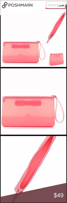"""❗1-HOUR SALE❗HUNTER Silicone Pouch Wristlet Clutch NEW WITH TAGS  HUNTER ORIGINAL Silicone Pouch Wristlet Clutch  * Zip closure & attached wristlet strap  * 5.5"""" strap drop  * Approx 5.75 H X 10.5"""" W X 1.25 D  * Logo detail  * Well made & durable opaque construction      Material: Silicone Color: Pink Item# # neon  🚫No Trades🚫 ✅ Offers Considered*✅ *Please use the blue 'offer' button to submit an offer. Hunter Bags Totes"""