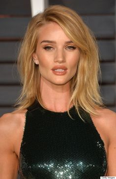 What else can we say about Rosie Huntington-Whiteley's sexy party hair? We will point out that her winged eyeliner, bronzed cheeks and nude lipstick (hello, pillow soft pout!) add the finishing touch.:
