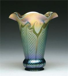 QUEZAL ART GLASS SHADE   Iridescent green and gold hooked feather decoration with ruffled edges.