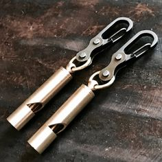 Carabiner of whistle. Colour Golden