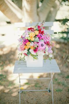 Colorful blooms in a white planter box
