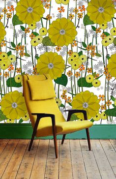 Yellow Mid Century Modern arm chair with Retro garden wall paper by Lucy…