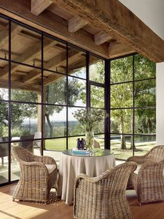 Mediterranean home with inviting design style in Austin - Pergola Ideas Steel Windows, Windows And Doors, Iron Windows, Black Windows, Ceiling Windows, Porch With Windows, Wall Of Windows, Corner Windows, Sunroom Windows