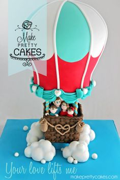 "Your love lifts me! 3D Hot Air Balloon Cake.  - A real learning cake for both myself and my lovely husband who helped me put it together.  The hot air balloon is split in two flavours. Top half is raspberry puree infused white chocolate ganache with vanilla bean cake, and bottom half chocolate mudcake with milk chocolate ganache. The 5"" basket is chocolate mudcake with chili chocolate ganache. The clouds are made from the offcuts on little cake boards.  Hope you like!  Nina xoxo"