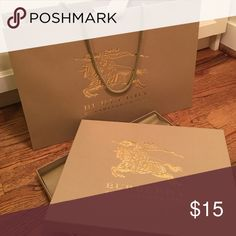 Medium Burberry shopping bag with ribbon and box Medium Burberry shopping bag with ribbon and box. Authentic, no damages, brand new condition. Burberry Bags