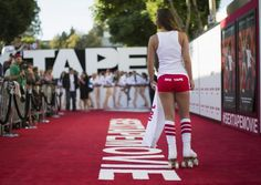 """A model roller-skates on the red carpet at the premiere of the film """"Sex Tape"""" in Los Angeles, California July 10, 2014. REUTERS/Mario Anzuoni"""
