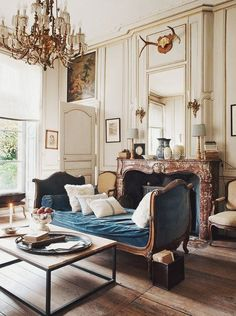 This is another French Country inspired space; the different wood and antler pieces help you see the country side and the ornate details give the atmosphere a richer feel.