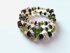 Green and brown beaded wrap bracelet, peridot, brown shells, freshwater pearl beaded boho stack bracelet, beaded cuff bracelet by barefootcreekjewelry on Etsy