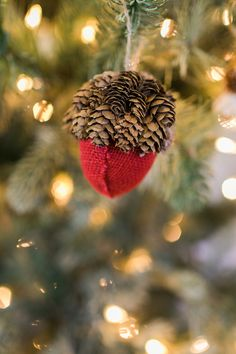 from shopcrackerbarrelcom add a touch of nature to your christmas tree with this red burlap acorn ornament from