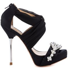 Whether you're tossing the bouquet or reaching for it!  The Bouquet will be the perfect wedding companion.  This lavish David Tutera silhouette delivers crossing black satin straps and jewel encrusted vamp.  A silver 5 inch heel and 1 inch platform complete this breathtaking stiletto.