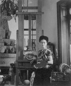 """Frida Kahlo Painting in the Blue House - TheCasa Azul (""""Blue House"""") in Coyoacán, Mexico City was the family home where Frida Kahlo grew up and to which she returned in her final years. Frida's father, Guillermo Kahlo, built the house in 1907 as the Kahlo family home. Leon Trotsky stayed at this house when he first arrived in Mexico in 1937."""