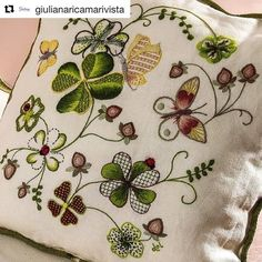 Embroidered cushion.
