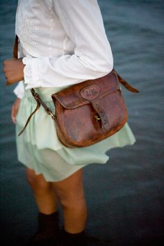 love worn brown leather handbags.  I try to imagine the places they've been.