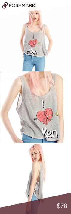 Wildfox Barbie Collection Hikers Tank M NWT Wildfox Couture 'Heartbroken by Ken' from the Barbie resort collection. Hikers tank in grey, size Medium. Brand new in original plastic packaging. Please ask any questions you may have prior to purchasing                    trades Wildfox Tops Tank Tops