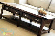 tutorial: Pottery Barn knock-off coffee table for about 100 bucks, with link to Ana White's furniture plans