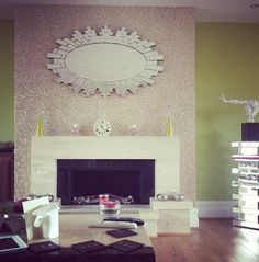 Glitter wall above and around the fireplace.