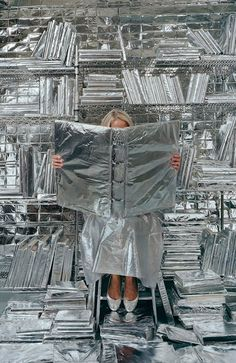 """""""Lost in My Life (wrapped books)"""" (2010), by Rachel Perry Welty. Part of Welty's series Lost in My Life."""
