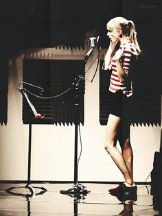 A MOST POPULAR RE-PIN: Recording studio photo of singer standing at microphone. Notice how her mouth is exactly at the microphone. 2 common mistakes: Microphone too high (because it LOOKED COOL on TV show to sing upward like that! OR to have mic too low-- common when singers do not put up their music stand high enough to avoid bending their throats-- thus hindering full singing potential. #cSw - http://www.pinterest.com/claxtonw/professional-recording-music-production/ - PROFESSIONAL STUDIO